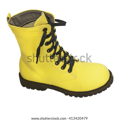 One high yellow boots with black laces on a white background - stock photo