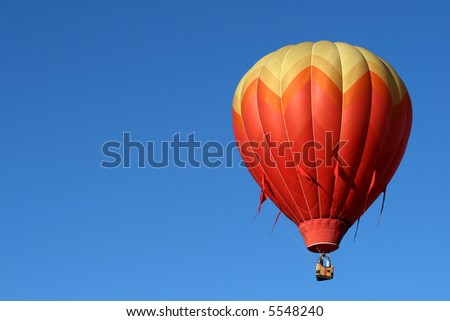 One hot air balloon during early morning ascend - stock photo