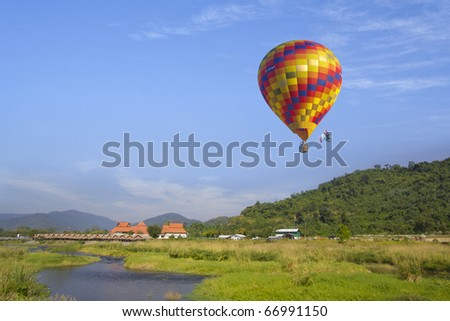 One hot air balloon over lake - stock photo