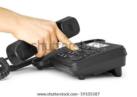 One human hand pressing key on phone - stock photo