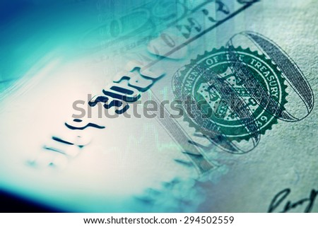 One hundred dollar and credit card. Macro image. - stock photo