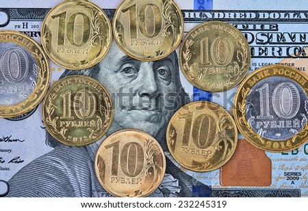 One hundred dollar banknote with russian coins on top. Closeup - stock photo