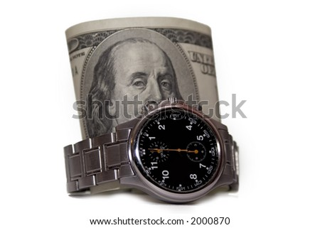One hundred dollar bill inside a silver wrist watch - stock photo