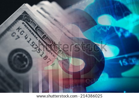 One hundred dollar bills and financial data. - stock photo