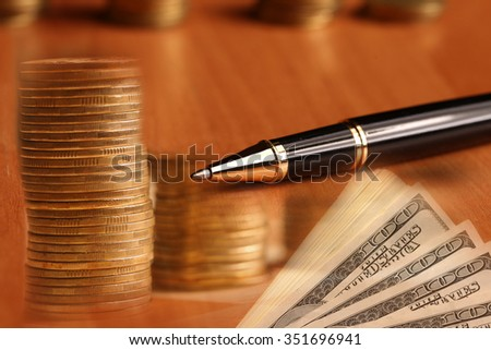 One hundred dollar bills and financial data.moneti and pen and dollars on the table - stock photo