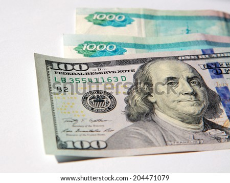 One Hundred Dollar Bills and Russian Rubles - stock photo