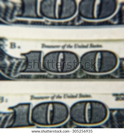 One Hundred Dollar Bills background with blurred defocusing - stock photo