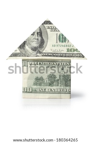 One hundred dollar bills folded into the shape of a house on white background