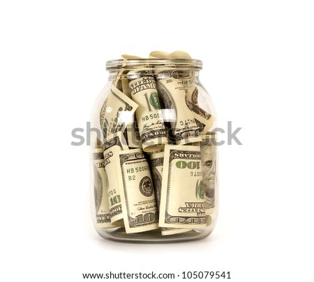 One hundred dollar bills in a glass jar - stock photo
