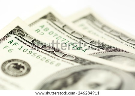 One hundred dollar bills, isolated on white. - stock photo