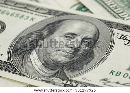 one hundred dollar bills macro photo, selective focus - stock photo