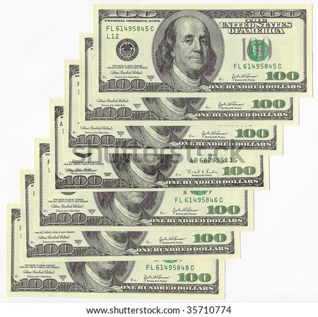 One hundred dollar bills on a white background.