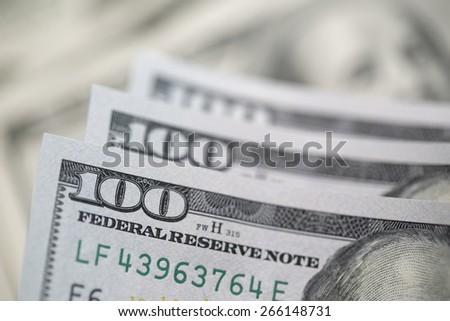One Hundred Dollar Bills with Narrow Depth of Field. - stock photo