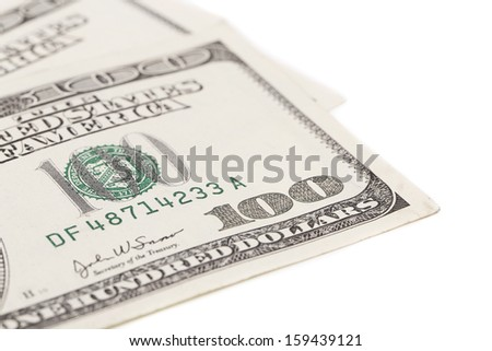One hundred dollar greenbacks. Isolated on a white backgropund.