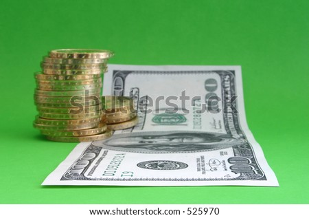 One hundred dollar note with coins #2, focus is set in the foreground, F/36.
