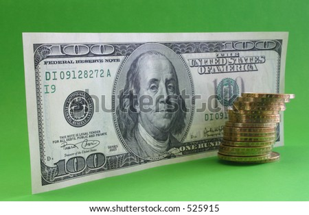 One hundred dollar note with coins -  focus is set on the left side, deep DOF (F/32). - stock photo
