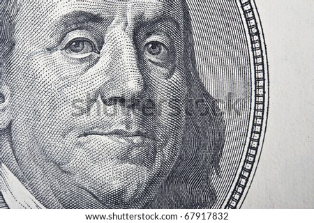 One hundred dollar on a white background