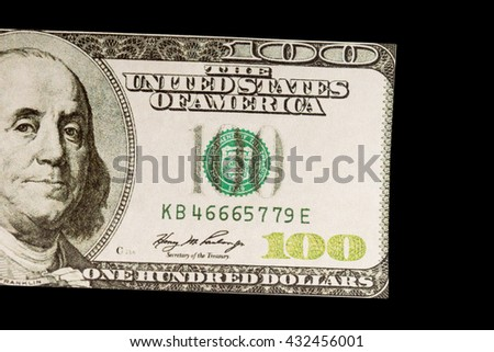 one hundred dollar on the black background - stock photo