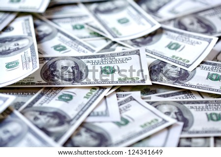 One hundred dollars background. Shallow depth of field - stock photo