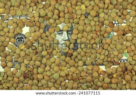 one hundred dollars banknote with grains lentils background - stock photo
