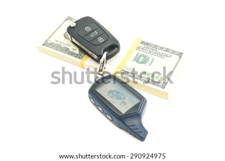 one hundred dollars banknotes and car keys on white