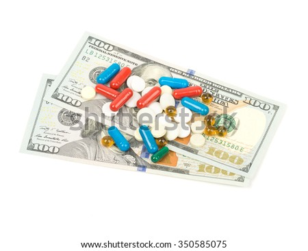 One hundred dollars banknotes and pill isolated on white background. - stock photo