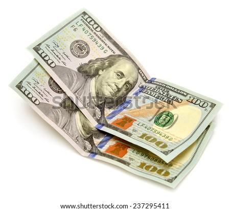 One hundred dollars banknotes isolated on white background - stock photo