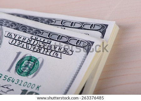 One hundred dollars banknotes on wood background  - stock photo