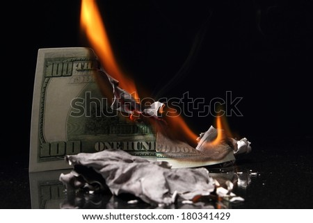 One hundred dollars in fire, burning dollar, ashes - stock photo