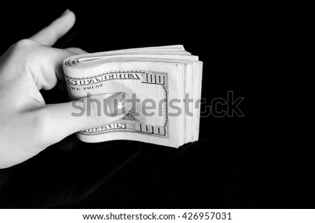 one hundred dollars in woman hand