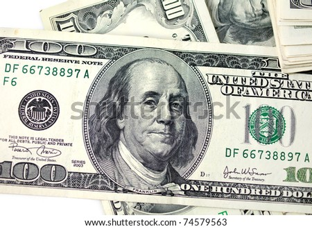 one hundred dollars isolated on white close-up photo
