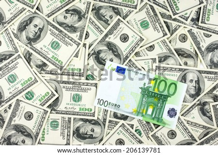 One hundred dollars pile and one hundred euro. - stock photo