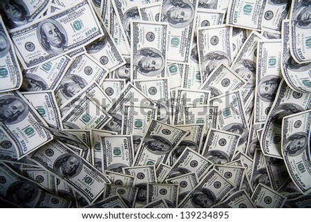 One hundred dollars pile as background - stock photo
