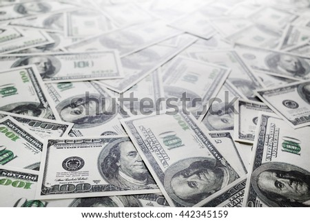 One hundred dollars pile. Money as background. Selective focus. - stock photo