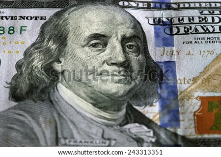 One Hundred Dollars. Selective focus on Benjamin Franklin eyes. USD, The United States currency, money concept - stock photo