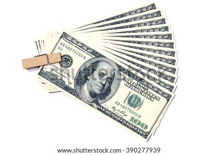 one hundred dollars with wooden clip on a white background