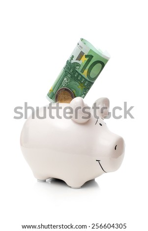One hundred euro banknote and two euro coin insert into white porcelain pig, isolated on white background - stock photo