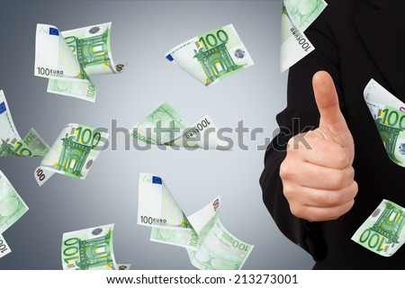One hundred euro money banknotes flying and falling down with confirmation sign of young business woman.