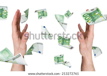 One hundred euro money banknotes flying and falling on young male hands, isolated on white background. - stock photo