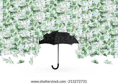 One hundred euro money banknotes flying and raining on black umbrella, isolated on white background. - stock photo