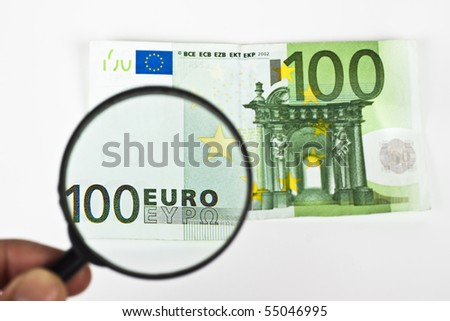 one hundred euro with magnifying glass on white background - stock photo