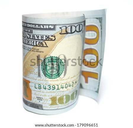 One hundred new dollars closeup on white background - stock photo