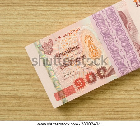 one hundred  thai banknotes put on table .  money concept - stock photo