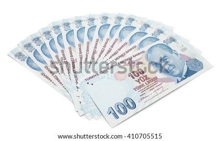 One hundred Turkish Lira bills isolated on white background. - stock photo