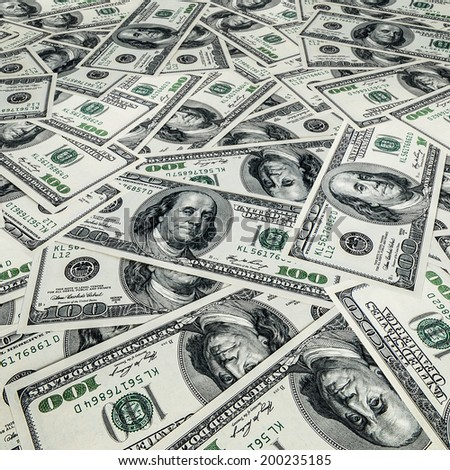 One hundred US dollars bills pile as background - stock photo