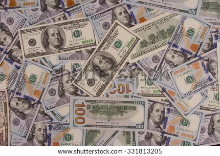 One hundred US dollars. Many banknotes. Benjamin Franklin, Independence Hall.  - stock photo