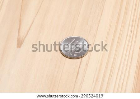One hundred yen on wooden table - stock photo