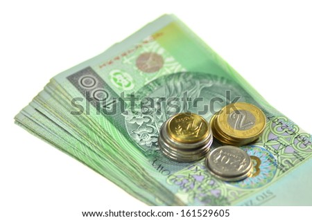 one hundred zloty banknotes and coins from poland - stock photo