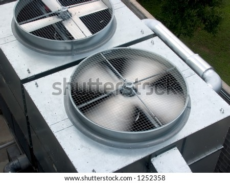 One HVAC unit with one spinnig blade and one motionless. - stock photo