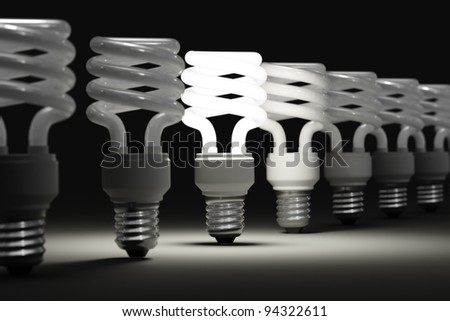 One illuminated light among many of the disabled - stock photo